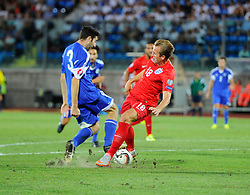 Harry Kane of England (Tottenham Hotspur) battles for the ball with Marco Berardi of San Marino (S.S. Folgore)  - Mandatory byline: Joe Meredith/JMP - 07966386802 - 05/09/2015 - FOOTBALL- INTERNATIONAL - San Marino Stadium - Serravalle - San Marino v England - UEFA EURO Qualifers Group Stage