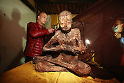 QUANZHOU, CHINA - JANUARY 10: (CHINA OUT) <br /> <br /> orkers clear the dust on monk Fuhou\'s body which was found not rotted after putting in a vat for three and a half years at Puzhao temple on Zimao Mountain on January 10, 2016 in Quanzhou, Fujian Province of China. 94-year-old monk Fuhou died in 2012 and his body was put by the sitting position into a vat with a cover for three and a half years. Monks found that Fuhou\'s body wasn\'t rotted on an opening vat rite on January 10 at Puzhao temple on Zimao Mountain in Quanzhou. The body would be cleaned and stuck with gold to be made into a golden Buddha. <br /> ©Exclusivepix Media
