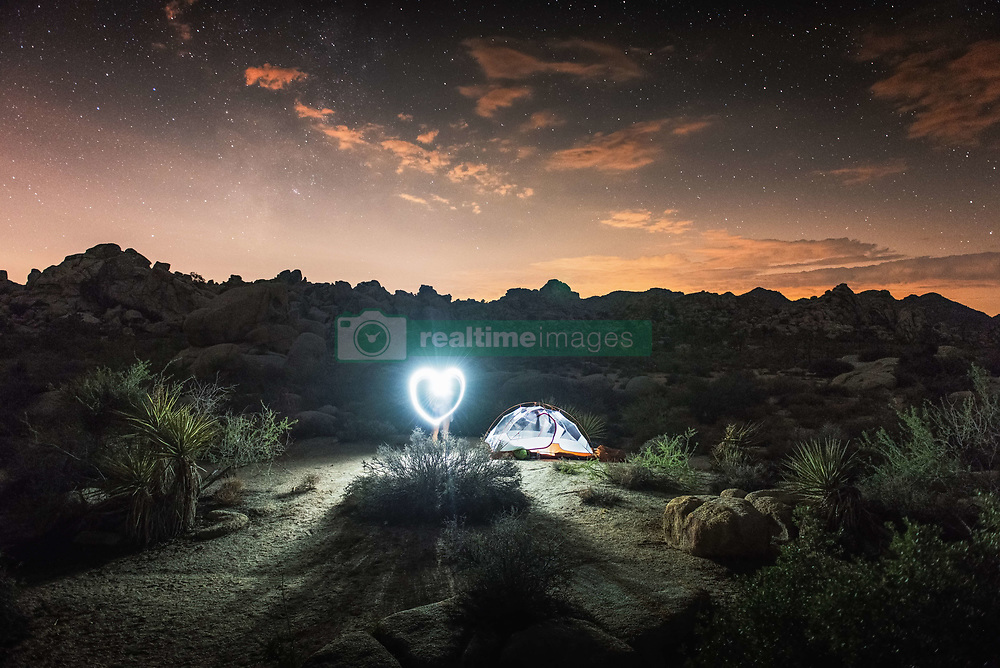 Sept. 14, 2014 - Illuminated tent by night, Joshua Tree National Park, California, US (Credit Image: © Image Source/Image Source/ZUMAPRESS.com)