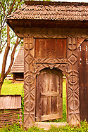 19th century traditional Iza Valley farm house carved  wooden folk art gates, The Village museum near Sighlet, Maramures, Northern Transylvania .<br /> <br /> Visit our ROMANIA HISTORIC PLACXES PHOTO COLLECTIONS for more photos to download or buy as wall art prints https://funkystock.photoshelter.com/gallery-collection/Pictures-Images-of-Romania-Photos-of-Romanian-Historic-Landmark-Sites/C00001TITiQwAdS8