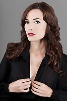 Closeup fashion portrait of beautiful woman isolated on gray background