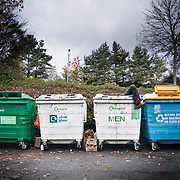 A humorous image depicting a recycling bin for unwanted, broken, useless or outdated men.