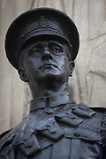 In the 100th year after WW1 started, a detail of a war memorial soldier's head and shoulders, a hero in Cornhill, City of London remembering those killed in the First World War, lost in the trenches and the fields of Flanders from 1914-19. Dedicated by the City of London, the UK capital's financial and historic heart. Two soldiers face away from each other with rifles between their boots, they represent a lost generation when the nation's youth sacrificed their lives in the 20th century's first great conflict. The inscription says that their names will live for evermore.