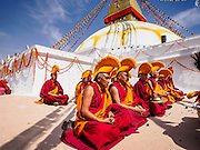07 MARCH 2017 - KATHMANDU, NEPAL: Buddhist lamas perform a consecration ceremony at Boudhanath Stupa. Boudhanath Stupa, the most important Buddhist site in Nepal and a popular tourist attraction, was consecrated Tuesday in a ceremony attended by thousands of Buddhist monks and Buddhist people from Nepal and Tibet. The stupa was badly damaged in the 2015 earthquake that devastated Nepal. The stupa, which reopened in November 2016, was repaired in about 18 months. The repair was financed by private donations raised by international Buddhist organizations.     PHOTO BY JACK KURTZ