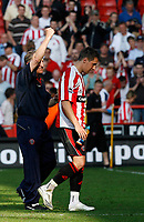 Photo: Paul Greenwood.<br />Sheffield United v West Ham United. The Barclays Premiership. 14/04/2007.<br />Sheffield United manager Neil Warnock (L) and captain Phil Jagielka celebrate victory at the end of the match