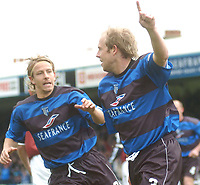 SPORTSBEAT IMAGES 01494 783165<br /> PICTURE ADY KERRY .<br /> GILLINGHAM VS IPSWICH TOWN<br /> GILLINGHAM'S JOHN HILLS CELEBRATES HIS PENALTY WITH DANNY SPILLER. 17TH APRIL 2004.
