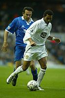 Photo. Andrew Unwin<br /> Leeds United v Birmingham City, Barclaycard Premier league, Elland Road, Leeds 20/09/2003.<br /> Leeds' Jermaine Pennant (r) shields the ball from Birmingham's Stan Lazaridis (l).