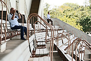 Lone punter watches from the stands in Race 5, FastTrack Mufhasa Stakes 1300.<br /> Vodafone Derby Day at Ellerslie Race Course, Auckland on Sunday 7th March 2021 during lockdown level 2.<br /> Copyright photo: Alan Lee / www.photosport.nz