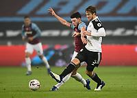 Football - 2020 /2021Premier League - West Ham United vs Fulham - The London Stadium<br /> <br /> West Ham United's Declan Rice battles with Fulham's Joachim Andersen.<br /> <br /> COLORSPORT/ASHLEY WESTERN
