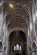 Interior view of the vaulted ceiling in the nave of Hereford Cathedral on 7th June 2021 in Hereford, United Kingdom. Hereford Cathedral is the cathedral church of the Anglican Diocese of Hereford, England. A place of worship has existed on the site of the present building since the 8th century or earlier. The present building was begun in 1079. Substantial parts of the building date from both the Norman and the Gothic periods.
