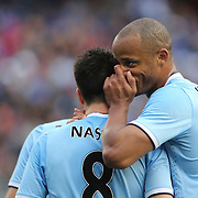 Vincent Kompany, Manchester City, talks with team mate Samir Nasri in action during the Manchester City V Chelsea friendly exhibition match at Yankee Stadium, The Bronx, New York. Manchester City won the match 5-3. New York. USA. 25th May 2012. Photo Tim Clayton