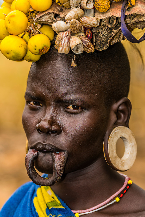 Mursi tribe woman, Mago National Park, Omo Valley, Ethiopia. The women have modified their lips to wear a clay disc.