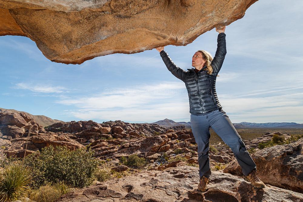 Sarah Hepola on lip of the Moonshine Roof, Hueco Tanks State Park & Historic Site, El Paso, Texas. USA.