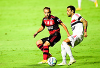 SAO PAULO, BRAZIL - FEBRUARY 25: Dani Alves of Sao Paulo FC competes for the ball with Everton Ribeiro of CR Flamengo ,during the Brasileirao Serie A 2020 match between Sao Paulo FC and CR Flamengo at Morumbi Stadium on February 25, 2021 in Sao Paulo, Brazil. (Photo by MB Media/BPA)