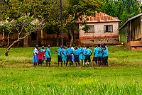 School children in uniform outside their school in Hoima, Uganda.