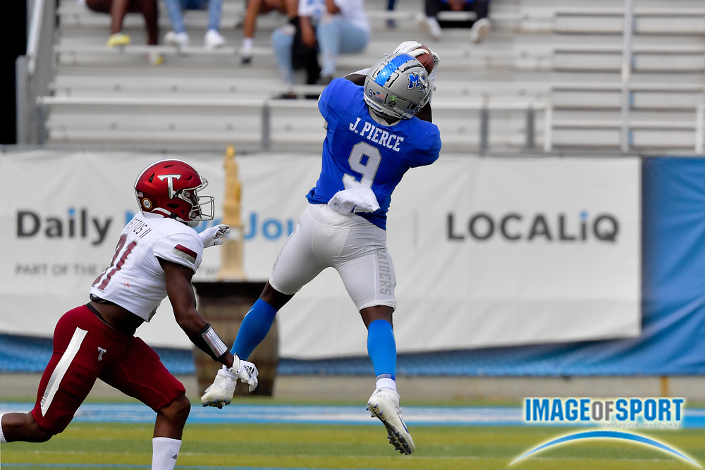 """Middle Tennessee Blue Raiders wide receiver Jarrin Pierce (9) catches a pass against Troy Trojans safety Dell Pettus (31) during the first half at Johnny """"Red"""" Floyd Stadium in Murfreesboro, Tenn., Saturday, Sept. 19, 2020. (Jim Brown/Image of Sport)"""