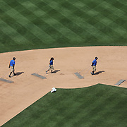 Ground staff prepare the infield between innings during the New York Mets V Philadelphia Phillies Baseball game at Citi Field, Queens, New York. USA. 20th July 2013. Photo Tim Clayton