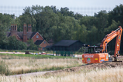 A mechanical digger is used close to Dews Farm for ground clearance work for the HS2 high-speed rail link on 13th July 2020 in Harefield, United Kingdom. Dews Farm, which was visited by Queen Elizabeth I in 1602 and was the birthplace of Victoria Cross holder Cecil John Kinross in 1896, is expected to be demolished in the near future.