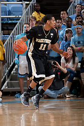 CHAPEL HILL, NC - FEBRUARY 15: C.J. Harris #11 of the Wake Forest Demon Deacons dribbles the ball while playing the North Carolina Tar Heels at the Dean E. Smith Center in Chapel Hill, North Carolina. North Carolina won 64-78. (Photo by Peyton Williams/UNC/Getty Images) *** Local Caption *** C.J. Harris