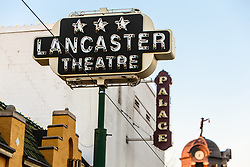 Marquee of Lancaster Theater on Main Street with Palace Theater and Nightwatchman sculpture in background, Grapevine, Texas USA