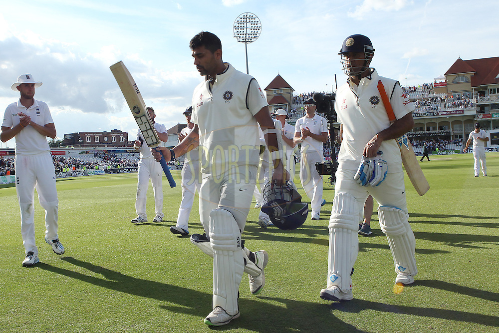 Murali Vijay of India and Mahendra Singh Dhoni captain of India leave the field at the end of the day during day one of the first Investec test match between England and India held at Trent Bridge cricket ground in Nottingham, England on the 9th July 2014<br /> <br /> Photo by Ron Gaunt / SPORTZPICS/ BCCI