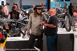 Podcaster Danger Dan Hardick and Scotty Bush at the What's the Skinny Exhibition (2019 iteration of the Motorcycles as Art annual series), which was popular with guests at the Sturgis Buffalo Chip, especially in the evenings before the big concerts during the Sturgis Black Hills Motorcycle Rally. SD, USA. Thursday, August 8, 2019. Photography ©2019 Michael Lichter.