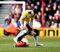 Bournemouth's Harry Arter and Huddersfield Town's Conor Coady tussle for the ball - Photo mandatory by-line: Paul Knight/JMP - Mobile: 07966 386802 - 14/02/2015 - SPORT - Football - Bournemouth - Goldsands Stadium - AFC Bournemouth v Huddersfield Town - Sky Bet Championship