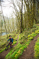 Mountain biking the Wilson River Trail near Tillamook, Oregon.