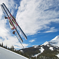 SKIING, Big Sky, Montana. Ben Wiltsie (MR) skis aerial manouvers and flips in half pipe in terrain park at Big Sky Ski Resort, near Bozeman, Montana. 11,166-foot Lone Mountain is in bkg. of most pictures.