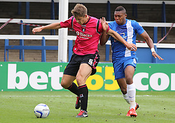 Oldham Athletic's James Tarkowski in action with Peterborough United's Britt Assombalonga  - Photo mandatory by-line: Joe Dent/JMP - Tel: Mobile: 07966 386802 17/08/2013 - SPORT - FOOTBALL - London Road Stadium - Peterborough -  Peterborough United V Oldham Athletic - Sky Bet League One