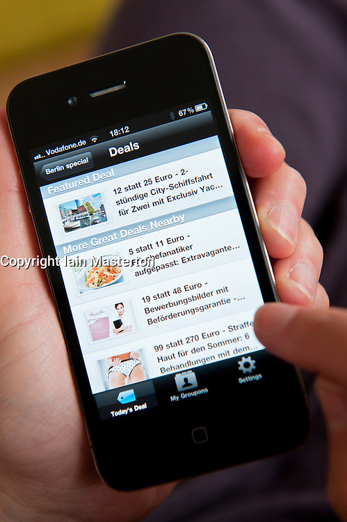 Groupon app showing deals in Berlin on an  iPhone 4G smart phone