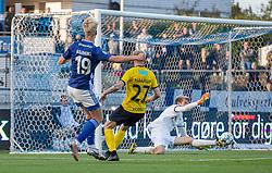 Jesper Rask (Hobro IK) redder afslutning fra Magnus Warming (Lyngby Boldklub) under kampen i 3F Superligaen mellem Lyngby Boldklub og Hobro IK den 20. juli 2020 på Lyngby Stadion (Foto: Claus Birch).