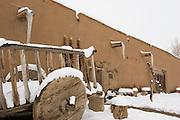 Martinez Hacienda with ancient cart in winter snow