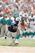 Miami Dolphins wide receiver Wes Welker tries to run past Tennessee Titans defensive back Reynaldo Hill during the Dolphins 13-10 victory over the Tennessee Titans on September 24, 2005 at Dolphins Stadium in Miami, Florida.
