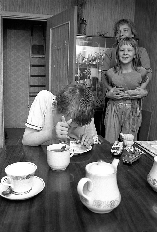 Disabled son, mother and sister.<br /> Trapped within a block of flats. Lift out of order and house bound.<br /> St Petersburg, Russia 1994