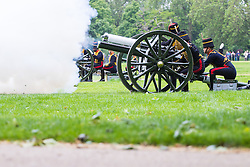 Hyde Park, London, June 2nd 2016. Soldiers and guns of the King's Troop Royal Horse Artillery fire a 41 round Royal Salute to mark the 63rd anniversary of the coronation of Britain's Monarch HM Queen Elizabeth II. PICTURED: A gun spews smoke as it fires.