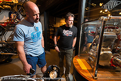 Patrick Griggs (L) and Paul Adams of Confederate Motorcycles checking out a cut away motor at the pre-party for the Handbuilt Motorcycle Show at Revival Cycles. Austin, TX. April 9, 2015.  Photography ©2015 Michael Lichter.