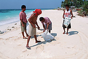 Workers collect sand (from the beach that is the main attraction for visitors) to build more accommodations for visitors Malapascua Island, central Philippines, Vizcayan Sea, Western Pacific Ocean