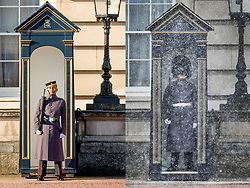 © Licensed to London News Pictures. Comparison picture showing a guard standing in warm weather conditions at Buckingham Palace in central London today, 26/02/2019 (LEFT) and on the same day last year, 26/02/2018 (RIGHT), in snowfall. Yesterday's high of over 20 degrees celsius was a record temperature for February. Photo credit: Rob Pinney/Peter Macdiarmid/LNP