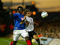 Fotball<br /> England<br /> Foto: SBI/Digitalsport<br /> NORWAY ONLY<br /> <br /> Portsmouth v Fulham<br /> <br /> Barclays Premiership. 30/08/2004<br /> <br /> Aiyegbeni Yakubu of Portsmouth clashes with Moritz Volz of Fulham