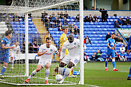 Wycombe midfielder Matthew Bloomfield (10) and Wycombe forward Adebayo Akinfenwa (20) celebrates after Wycombe defender Jason McCarthy (26) pulled one back for Wycombe 2-1  during the EFL Sky Bet League 1 match between Peterborough United and Wycombe Wanderers at London Road, Peterborough, England on 2 March 2019.