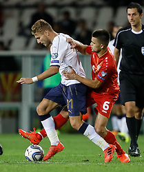 October 6, 2017 - Turin, Italy - Ciro Immobile (L) of Italy national team and Visar Musliu of FYR Macedonia national team vie for the ball during the 2018 FIFA World Cup Russia qualifier Group G football match between Italy and FYR Macedonia at Stadio Olimpico on October 6, 2017 in Turin, Italy. (Credit Image: © Mike Kireev/NurPhoto via ZUMA Press)