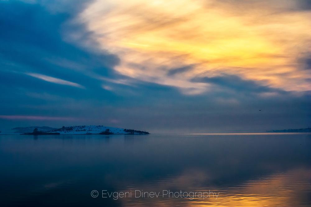 Island in a calm lake at blue hour