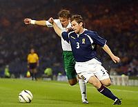 Photo Aidan Ellis.<br /> Scotland v Slovenia.<br /> 2006 FIFA World Cup Qualifier.<br /> Hampden Park Glasgow.<br /> 08/09/2004.<br /> Scotland's Gary Naysmith tussles with Slovenia'sMatej Mavric<br /> <br /> NORWAY ONLY