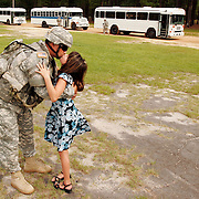 """Chief Warrant Officer 4 Tony Moschella of Lodi, California kisses his daughter Sarah Moschella  goodbye after the 316th Expeditionary Sustainment Command deployment ceremony at Pikes Field, Fort Bragg, N.C. on July 2nd, 2007 as busses wait to take him away...""""Goodbye Kiss"""""""