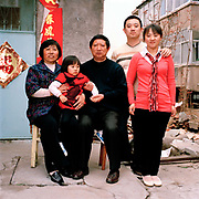 Zhou Chun Ying 60 is retired. She looks after her grand-daughter Han Lin, 2 in Quixa, Shandong province whilst her parents work in the factories 70 km away. Yan Wei ( Ying's son)  works in a chemical factory whilst her mother, Lin Chun Mei, the daughter-in-law works in a factory producing medical curtains. Despite the policy, there are still too many people and not enough jobs in China which means couples often have to work away and children are looked after by their grandparents. ..Its over thirty years (1978) since the Mao's Chinese government brought in the One Child Policy in a bid to control the world's biggest, growing population. It has been successful, in controlling growth, but has led to other problems. E.G. a gender in-balance with a projected 30 million to many boys babies; Labour shortages and a lack of care for the elderly.