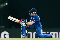 © Licensed to London News Pictures. 27/09/2012. Englishmen Eoin Morgan plays a reverse sweep shot during the T20 Cricket World super 8's match between England Vs West Indies at the Pallekele International Stadium Cricket Stadium, Pallekele. Photo credit : Asanka Brendon Ratnayake/LNP