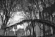 France. Paris,  11th district.  Canal Saint Martin, reflection in the water   / Paris les ponts sur le canal saint Martin