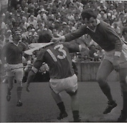 In the 1973 Munster final between Limerick and Tipperary, Eamon Cregan watches as Frankie Nolan (13) gets and early goal, with Ned Rea in attendance. The switch of Cregan to centre back for the final with Kilkenny was vital in Limerick winning their seventh title.