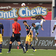 Jeb Brovsky, NYCFC, tumbles from a challenge by Sacha Kljestan, New York Red Bulls, during the New York City FC Vs New York Red Bulls, MSL regular season football match at Yankee Stadium, The Bronx, New York,  USA. 28th June 2015. Photo Tim Clayton